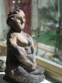"Pit Fired Clay Figure 8"" H"